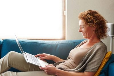 Adult woman learns about personal finance from the comfort of home