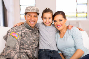 military family sitting on the couch