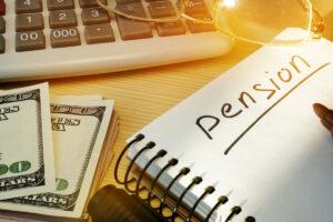 cuaderno con la palabra pension