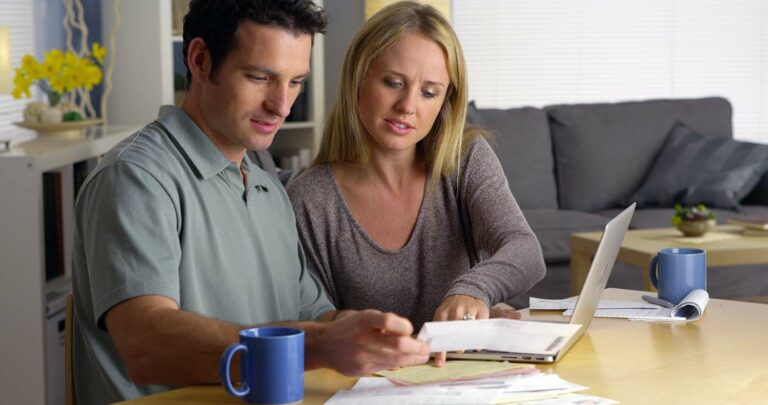 A couple budgets at home and manages their finances together