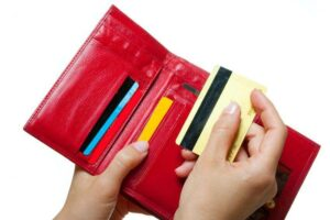 Old credit cards in a red wallet