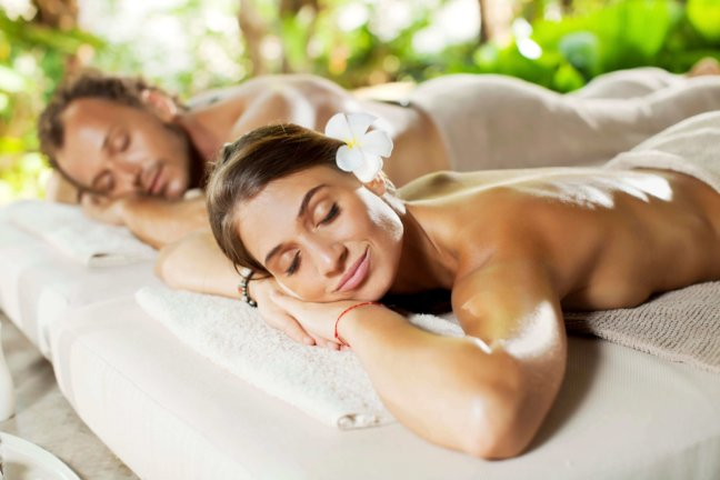 Couple relaxes at a spa getting a massage