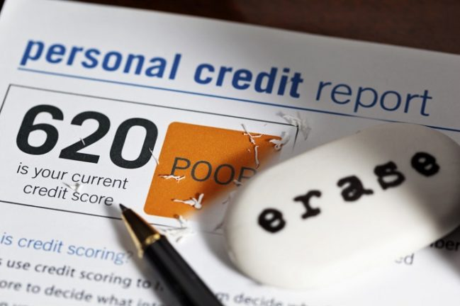 how to build credit; credit report paper with an eraser and pen