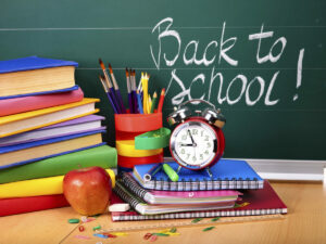 back to school shopping; back to school supplies in front of a chalkboard