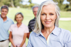 women and money, retirement; smiling retired woman
