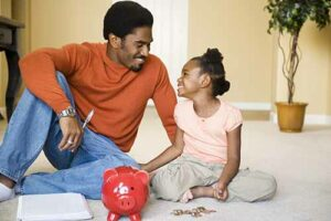 Single father teaches his daughter to save
