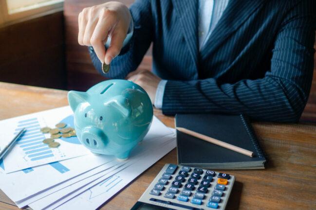 Saving Money While Being in Debt