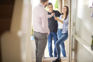 how do mortgages work?; young couple receiving their property keys