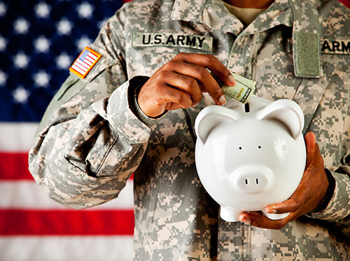 military man with piggy bank