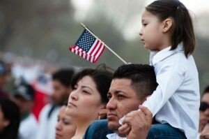 A Hispanic family watches a parade in the U.S.