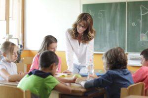 Woman teaches elementary class