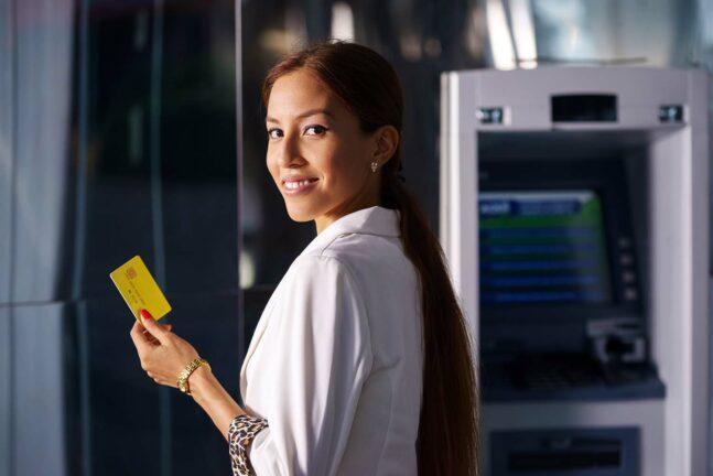 Hispanic woman at an ATM